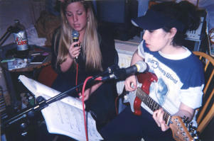 Amy Winehouse (right) in a still from 'Amy' 2015