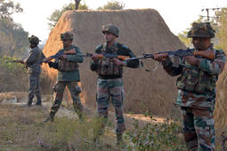 File: Indian army soldiers take up position on the perimeter of an airforce base in Pathankot on January 3, 2016, during an operation to 'sanitise' the base following an attack by gunmen.