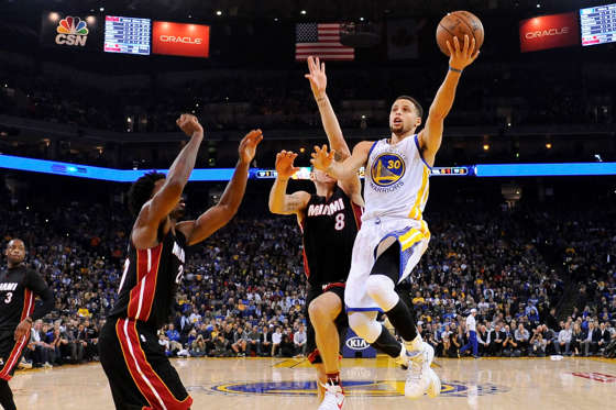Golden State Warriors guard Stephen Curry (30) shoots the basketball against Miami Heat forward Justise Winslow (20) and guard Tyler Johnson (8) on Jan. 11 in Oakland. Warriors won 111-103.