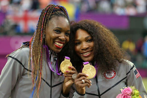 "Slide 87 of 100: <p xmlns=""http://www.w3.org/1999/xhtml"">Gold medalists Serena Williams and Venus Williams celebrate during the medal ceremony after winning the Women's Doubles Tennis at the 2012 London Olympics. The sisters won their third doubles gold medal, having already won in 2000 and 2008.</p>"
