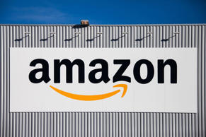 The Amazon logo is seen on the Amazon logistics center in Lauwin-Planque, northern France, Thursday, Sept. 19, 2013.