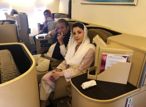 Ousted Pakistani Prime Minister Nawaz Sharif and his daughter Maryam sit on a Lahore-bound flight due for departure, at Abu Dhabi International Airport