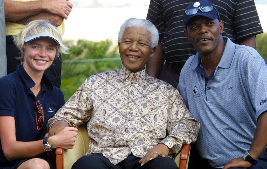 Slide 26 of 28: Former South African President Nelson Mandela (C), British super-model Jodie Kidd (L) and US actor Samuel L Jackson pose for photographers during the prize-giving ceremony at the end of the Nelson Mandela Invitational Golf Tournament at the Arabella Country Estate, about 100 kms outside of Cape Town 17 November 2003. The sporting charity event raised well over ZAR2 million (about US $ 300,000 ), which is split between the Nelson Mandela Children's Fund and the Gary Player Foundation. AFP PHOTO/ANNA ZIEMINSKI (Photo credit should read ANNA ZIEMINSKI/AFP/Getty Images)