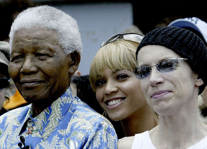 Slide 15 of 28: CAPE TOWN, SOUTH AFRICA - NOVEMBER 28: Nelson Mandela (L), singer Beyonce Knowles (C) and singer Annie Lennox (L) after a press conference for the '46664 - Give One Minute of Your Life to Aids' concert on November 28, 2003 on Robben Island, off the coast of Cape Town, South Africa. The concert will take place at Greenpoint Stadium on November 29th and will benefit the Nelson Mandela Foundation and the fight against AIDS in Africa. Artists performing will include Bono, Queen, Peter Gabriel, The Eurythmics, Beyonce, Youssou N'Dour, and many other international and African musicians. It will be one of the biggest rock events ever staged in Africa and will also be the most widely distributed media event in history with a potential audience of more than 2 billion people in 166 countries. (Photo by Frank Micelotta/Getty Images)