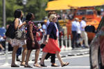Pedestrians cross Pennsylvania Avenue NW in an almost three-digit heat in Washington, Sunday, July 1, 2018. (AP Photo/Manuel Balce Ceneta)