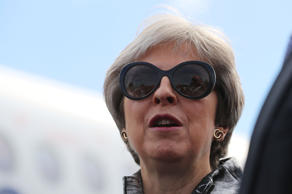 Britain's Prime Minister, Theresa May arrives to open the Farnborough Airshow, in Farnborough, Britain July 16, 2018.  Matt Cardy/Pool via REUTERS