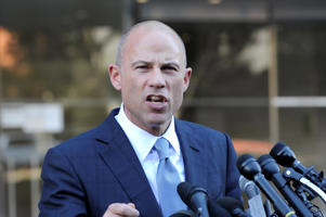 Michael Avenatti speaks to the media outside the U.S. District Court in Los Angeles, California, on September 24, 2018.