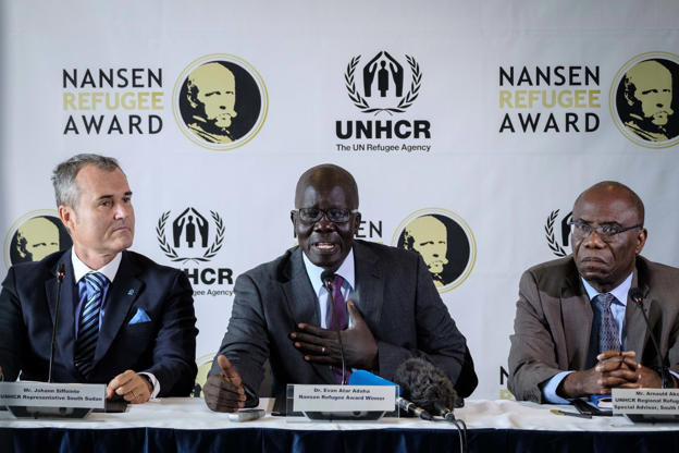 Slide 2 of 35: South Sudanese surgeon Evan Atar Adaha (C), sits next to UNHCR Representative to South Sudan, Johann Siffointe (L), and UNHCR Regional Refugee Coordinator and Special Advisor for the South Sudan Situation, Arnauld Akodjenou, during a press conference in the Kenyan capital Nairobi, on September 25, 2018, after winning UNHCRs 2018 Nansen Refugee Award. - Adaha was honoured for his 20-year commitment in providing medical care to people fleeing the violence in Sudan and South Sudan.  The 2018 Nansen Award Ceremony will be held on October 1 in Geneva and the keynote address will be given by actress Cate Blanchett, UNHCR Goodwill Ambassador. (Photo by Yasuyoshi CHIBA / AFP)        (Photo credit should read YASUYOSHI CHIBA/AFP/Getty Images)
