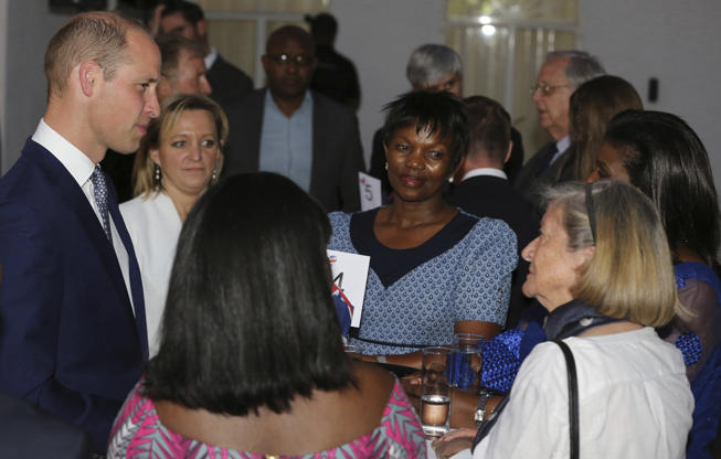 Slide 1 of 35: Britain's Prince William, left, talks with NGO guests at the British High Commissioner residence in Windhoek, Namibia, Tuesday, Sept. 25, 2018. Prince William is in Africa this week to discuss threats to conservation ahead of a London conference on the illegal wildlife trade. (AP Photo/Dirk Heinrich)