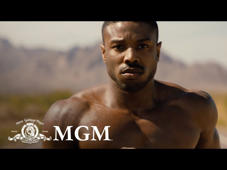 "a close up of a person: IN THEATERS NOVEMBER 21.  Life has become a balancing act for Adonis Creed. Between personal obligations and training for his next big fight, he is up against the challenge of his life. Facing an opponent with ties to his family's past only intensifies his impending battle in the ring. Rocky Balboa is there by his side through it all and, together, Rocky and Adonis will confront their shared legacy, question what's worth fighting for, and discover that nothing's more important than family. Creed II is about going back to basics to rediscover what made you a champion in the first place, and remembering that, no matter where you go, you can't escape your history.  Cast: Michael B. Jordan, Sylvester Stallone, Tessa Thompson, Wood Harris, Russell Hornsby, Florian ""Big Nasty"" Munteanu, Andre Ward, Phylicia Rashad, Dolph Lundgren  Connect with Creed II: WEBSITE: http://creedthemovie.com/ FACEBOOK: https://www.facebook.com/creedmovie INSTAGRAM: https://www.instagram.com/creedmovie/ TWITTER: https://twitter.com/creedmovie #Creed2  About MGM Studios: Metro-Goldwyn-Mayer Inc. is a leading entertainment company focused on the production and distribution of film and television content globally.  The company owns one of the world's deepest libraries of premium film and television content.  In addition, MGM has investments in domestic and international television channels, including MGM-branded channels.  Connect with MGM Studios Online Visit the MGM Studios WEBSITE: http://www.mgm.com/ Like MGM Studios on FACEBOOK: https://www.facebook.com/mgm/ Follow MGM Studios on TWITTER: https://twitter.com/MGM_Studios  CREED II 