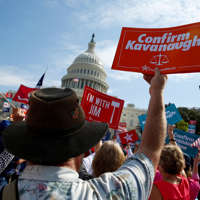 A supporter of Rep. Jim Jordan (R-OH) holds up sign calling for the confirmation of U.S. Supreme Court nominee Brett Kavanaugh during a rally in support of Jordan's bid to become the next Speaker of the House at the Capitol in Washington, U.S., September 26, 2018. REUTERS/Joshua Roberts