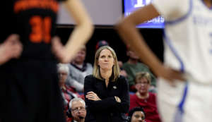 Princeton head coach Courtney Banghart looks on during the first half of a first round women's college basketball game against Kentucky in the NCAA Tournament in Raleigh, N.C., Saturday, March 23, 2019. (AP Photo/Gerry Broome)