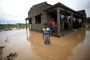 Agiro Cavanda and his wife Agera wade through floodwaters outside their home, flooded in the aftermath of Cyclone Kenneth, at Wimbe village in Pemba, Mozambique, April 29.