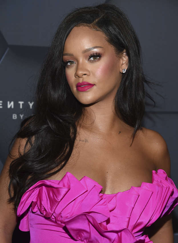 f23de06cd4f Rihanna rocks multi-colored eyeliner in a VERY sultry Fenty Beauty shoot as  she launches new makeup products that she has been secretly modeling for  over a ...