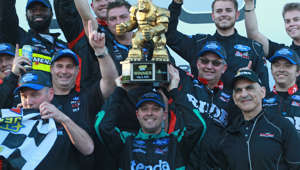 DOVER, DE - MAY 03:  Johnny Sauter, driver of the #13 Tenda Heal Ford, celebrates in Victory Lane after winning the NASCAR Gander Outdoors Truck Series JEGS 200 at Dover International Speedway on May 3, 2019 in Dover, Delaware.  (Photo by Matt Sullivan/Getty Images)