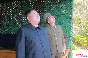 This Saturday, May 4, 2019, photo provided on Sunday, May 5, 2019, by the North Korean government shows North Korean leader Kim Jong Un observing tests of different weapons systems, in North Korea.