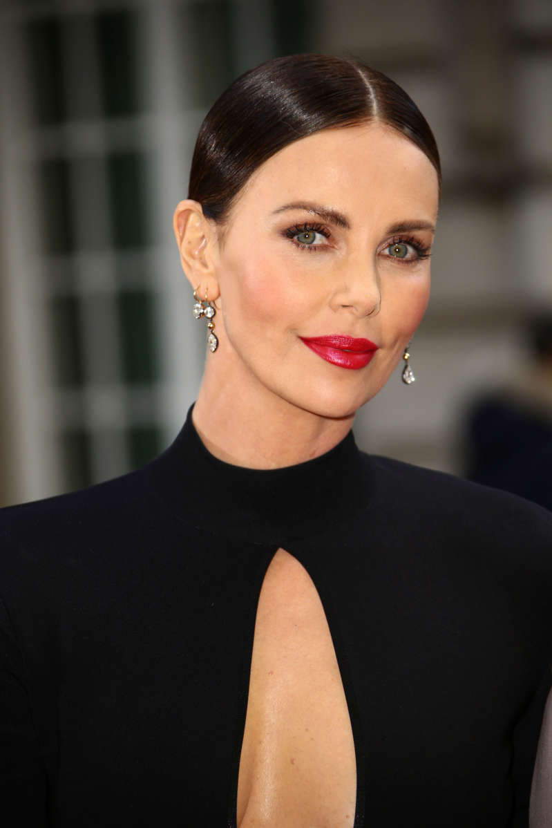 Charlize Theron poses for photographers at the premiere of the film 'Long Shot' in London, Thursday, April 25, 2019. (Photo by Joel C Ryan/Invision/AP)