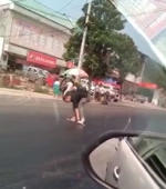 It's so hot in China that a man got stuck in melted tarmac trying to cross the road