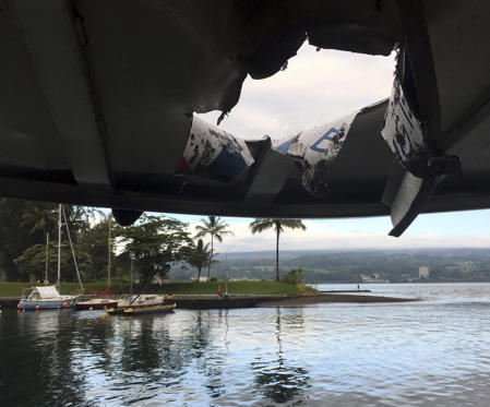 Slide 1 of 103: This photo provided by the Hawaii Department of Land and Natural Resources shows damage to the roof of a tour boat after an explosion sent lava flying through the roof off the Big Island of Hawaii Monday, July 16, 2018, injuring at least 23 people. The lava came from the Kilauea volcano, which has been erupting from a rural residential area since early May. (Hawaii Department of Land and Natural Resources via AP)