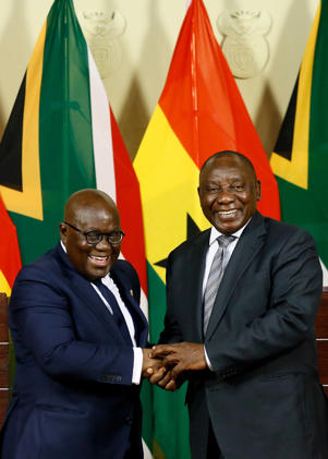 Ghana President Nana Akufo-Addo (L) and South African President Cyril Ramaphosa shake hands after addressing a joint press conference following their meeting at the Union Building in Pretoria, on July 5, 2018, during Akufo-Addo's official state visit. (Photo by Phill Magakoe / AFP)        (Photo credit should read PHILL MAGAKOE/AFP/Getty Images)