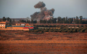 A picture taken on July 23, 2018 from the Israeli-annexed Golan Heights shows a smoke plume rising during air strikes backing a Syrian-government-led offensive in the southwestern province of Daraa. - Israel has been on high alert since June 19, when Syrian government forces launched a Russia-backed offensive to retake Quneitra and Daraa and provinces, adjacent respectively to the Israeli-held section of the Golan and to Jordan, and have regained control of most of these two provinces through a combination of deadly bombardment and Moscow-brokered surrender deals. (Photo by JALAA MAREY / AFP)        (Photo credit should read JALAA MAREY/AFP/Getty Images)