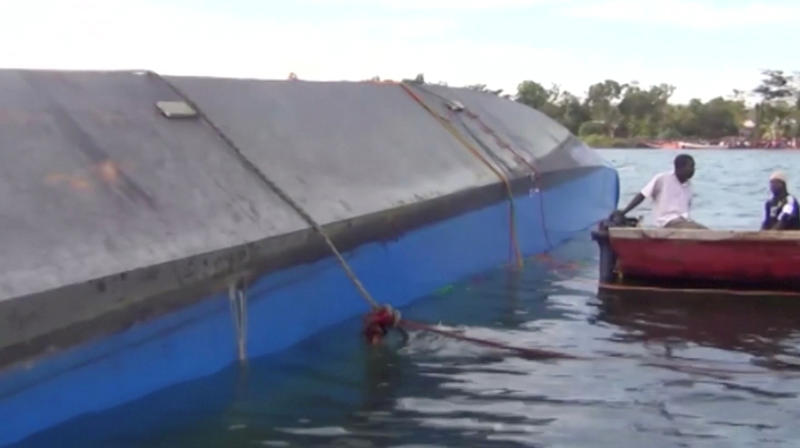 Rescue workers examine the hull of a ferry that overturned in Lake Victoria, Tanzania September 21, 2018, in this still image taken from video. Reuters TV/via REUTERS