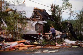 People collect personal effects from damaged homes following a tornado in Dunrobin, Ont., west of Ottawa Sept. 21, 2018. A tornado damaged cars in Gatineau, Que., and houses in a community west of Ottawa on Friday afternoon as much of southern Ontario saw severe thunderstorms and high wind gusts, Environment Canada said.