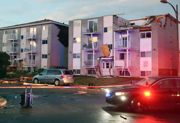 Slide 5 of 21: Apartment buildings are shown after a tornado torn roofs off and windows blown out after a tornado caused extensive damage to a Gatineau, Que. neighbourhood forcing hundreds of families to evacuate their homes on Sept. 21, 2018. A tornado damaged cars in Gatineau, Que., and houses in a community west of Ottawa on Friday afternoon as much of southern Ontario saw severe thunderstorms and high wind gusts, Environment Canada said.