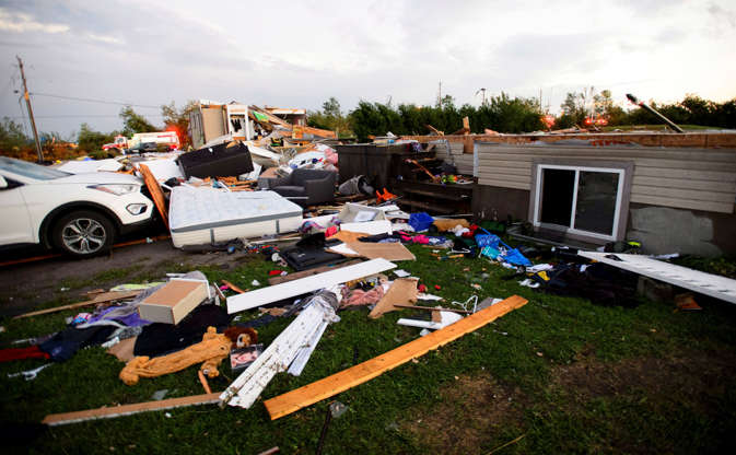 Slide 6 of 21: People collect personal effects from damaged homes following a tornado in Dunrobin, Ont. west of Ottawa on Sept. 21, 2018. A tornado damaged cars in Gatineau, Que., and houses in a community west of Ottawa on Friday afternoon as much of southern Ontario saw severe thunderstorms and high wind gusts, Environment Canada said.