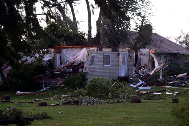 Slide 11 of 21: Damage from a tornado is seen in Dunrobin, Ont. west of Ottawa on Sept. 21, 2018. A tornado damaged cars in Gatineau, Que., and houses in a community west of Ottawa on Friday afternoon as much of southern Ontario saw severe thunderstorms and high wind gusts, Environment Canada said.