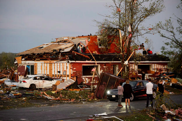 Slide 14 of 21: People collect personal effects from damaged homes following a tornado in Dunrobin, Ont. west of Ottawa on Sept. 21, 2018. A tornado damaged cars in Gatineau, Que., and houses in a community west of Ottawa on Friday afternoon as much of southern Ontario saw severe thunderstorms and high wind gusts, Environment Canada said.