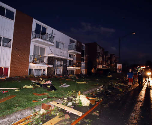 Slide 3 of 21: Apartment buildings are shown when roofs off and windows were blown out after a tornado caused extensive damage to a Gatineau, Que. A tornado damaged cars in Gatineau, Que., and houses in a community west of Ottawa on Friday afternoon as much of southern Ontario saw severe thunderstorms and high wind gusts, Environment Canada said.