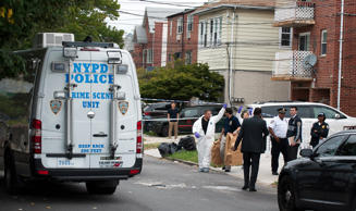 Police gather outside a daycare center in a private home, after a stabbing in the Queens borough of New York, U.S., September 21, 2018.