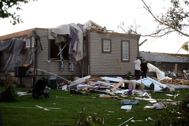 Slide 1 of 21: A young couple surveys the damage to their home following a tornado in Dunrobin, Ont. west of Ottawa on Sept. 21, 2018. A tornado damaged cars in Gatineau, Que., and houses in a community west of Ottawa on Friday afternoon as much of southern Ontario saw severe thunderstorms and high wind gusts, Environment Canada said.
