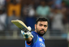 Indian cricket team captain Rohit Sharma celebrates after scoring a century (100 runs) during the one day international (ODI) Asia Cup cricket match between Pakistan and India at the Dubai International Cricket Stadium in Dubai on September 23, 2018. (Photo by ISHARA S. KODIKARA/AFP/Getty Images)