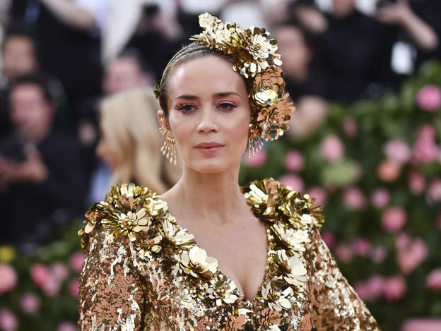 670700594e0 Met Gala 2019  Emily Blunt takes a style risk in a VERY quirky gold sequin  dress as she joins Sienna Miller and Rosie Huntington-Whiteley in leading  the ...