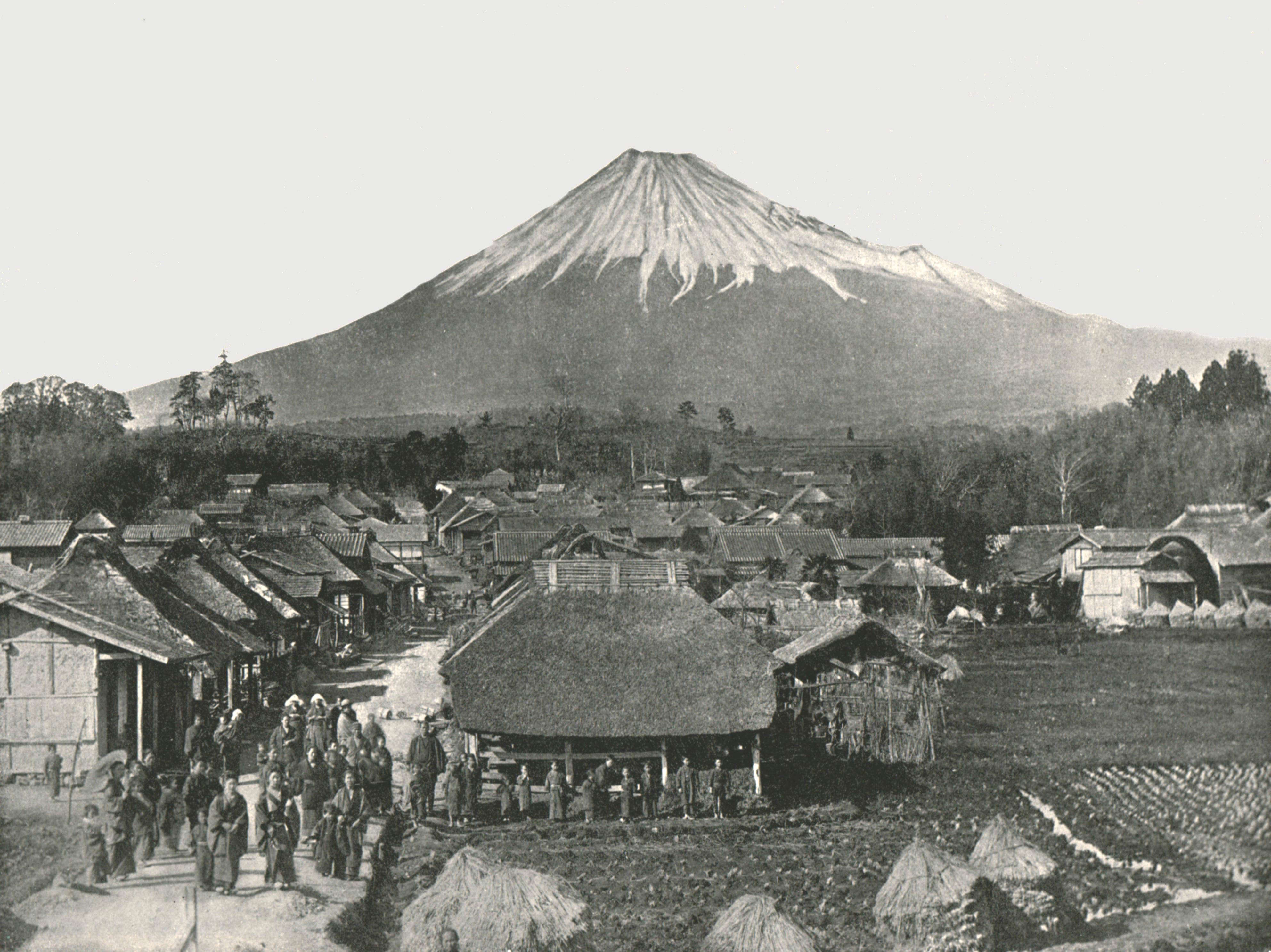 """Slide 4 of 55: Fujiyama, The Sacred Mountain, from Jedzumi Village', Japan, 1895. View of Mount Fuji, which at 3,776.24 metres (12,389 feet) is the highest volcano in Japan. From """"Round the World in Pictures and Photographs: From London Bridge to Charing Cross via Yokohama and Chicago"""". [George Newnes Ltd, London, 1895]. Artist Unknown. (Photo by The Print Collector/Getty Images)"""