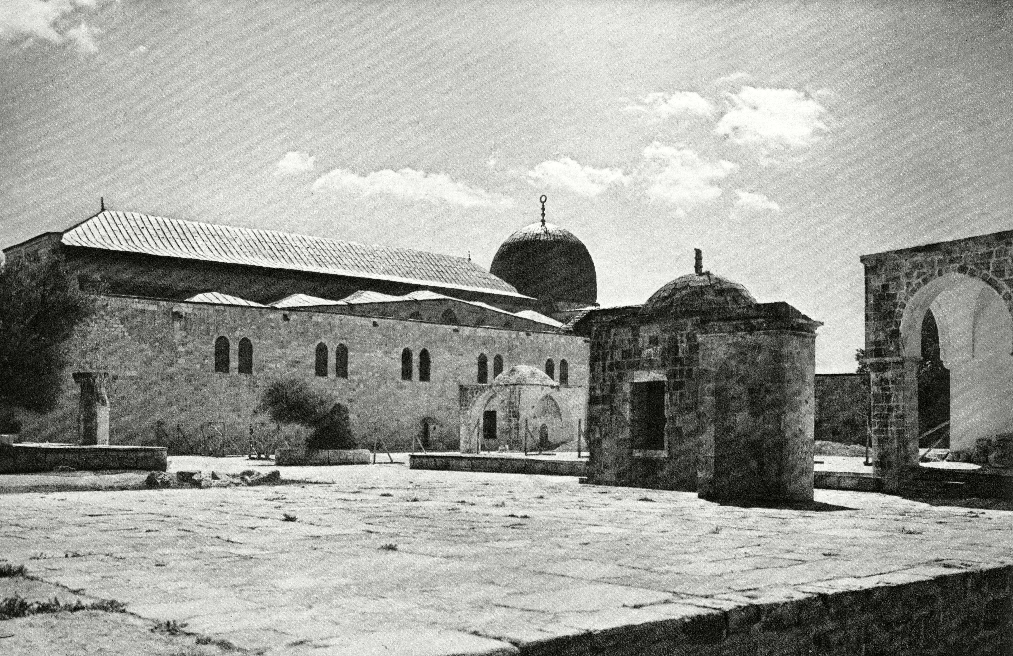 Slide 43 of 55: Side View of Al Aqsa (el Aksa) Mosque Jerusalem. . Unattributed Photograph in Palestine and Transjordania by Ludwig Preiss and Paul Rohrbach, 1926