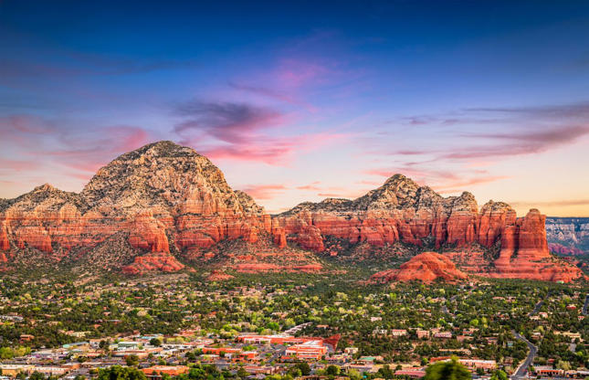 Slide 7 of 31: While Sedona isn't always cheap to visit, you can find some hotels for as little as $100 per night during off-peak months in the summer and fall. Book a stay to enjoy the iconic red rock scenery and plan some extraordinary (and free) hikes on the Cathedral Rock, Fay Canyon and Devil's Bridge trails.