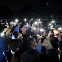 HIGHLANDS RANCH, CO - MAY 8:  Students protesting the media and politicians brought their vigil outside of Highlands Ranch High to honor their fallen friend Kendrick Castillo by lighting up their phones in the rain on May 8, 2019 in Highlands Ranch, Colorado.  STEM students at the vigil burst into a spontaneous demonstration after they were asked to speak at the organized event. The students left the gym and started chanting