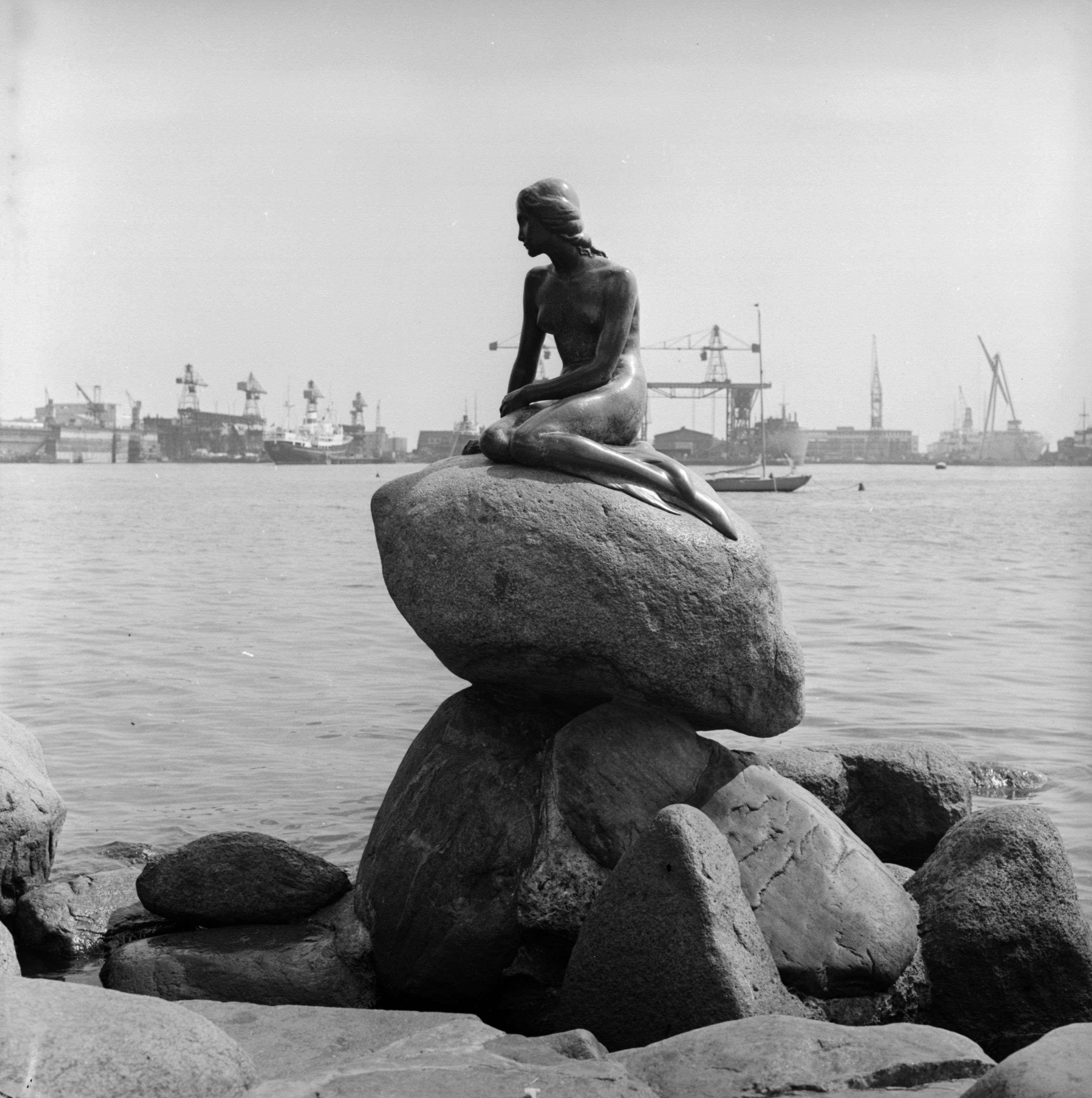 Slide 20 of 55: 30th May 1957: The Little Mermaid statue in Copenhagen, Denmark. (Photo by Derek Berwin/Fox Photos/Getty Images)