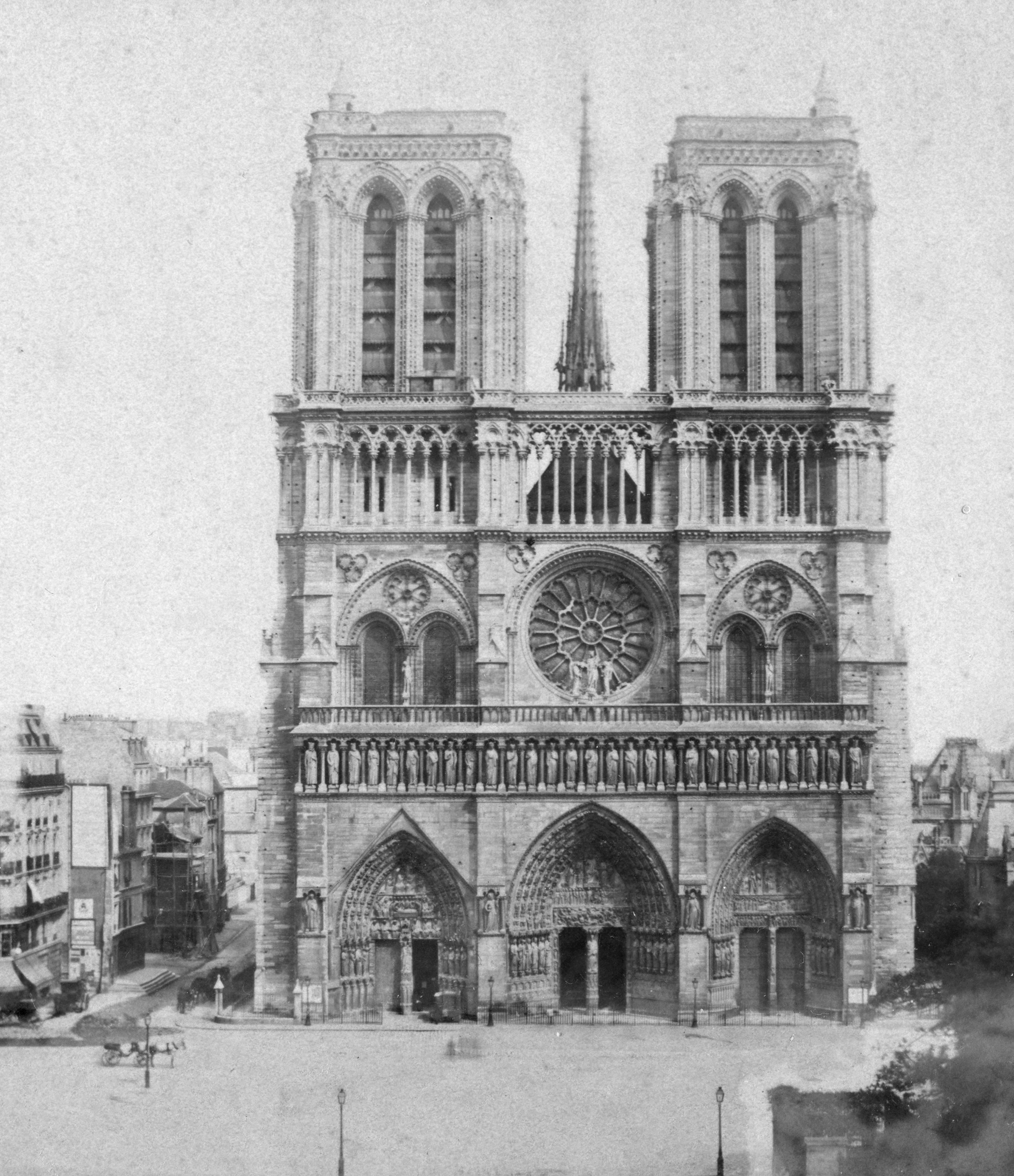 Slide 31 of 55: Notre Dame de Paris, France, late 19th or early 20th century. The Gothic Cathedral of Notre Dame de Paris was begun in the 12th century. The western facade was built between c1200 and 1225. Stereoscopic card. Detail. (Photo by The Print Collector/Print Collector/Getty Images)