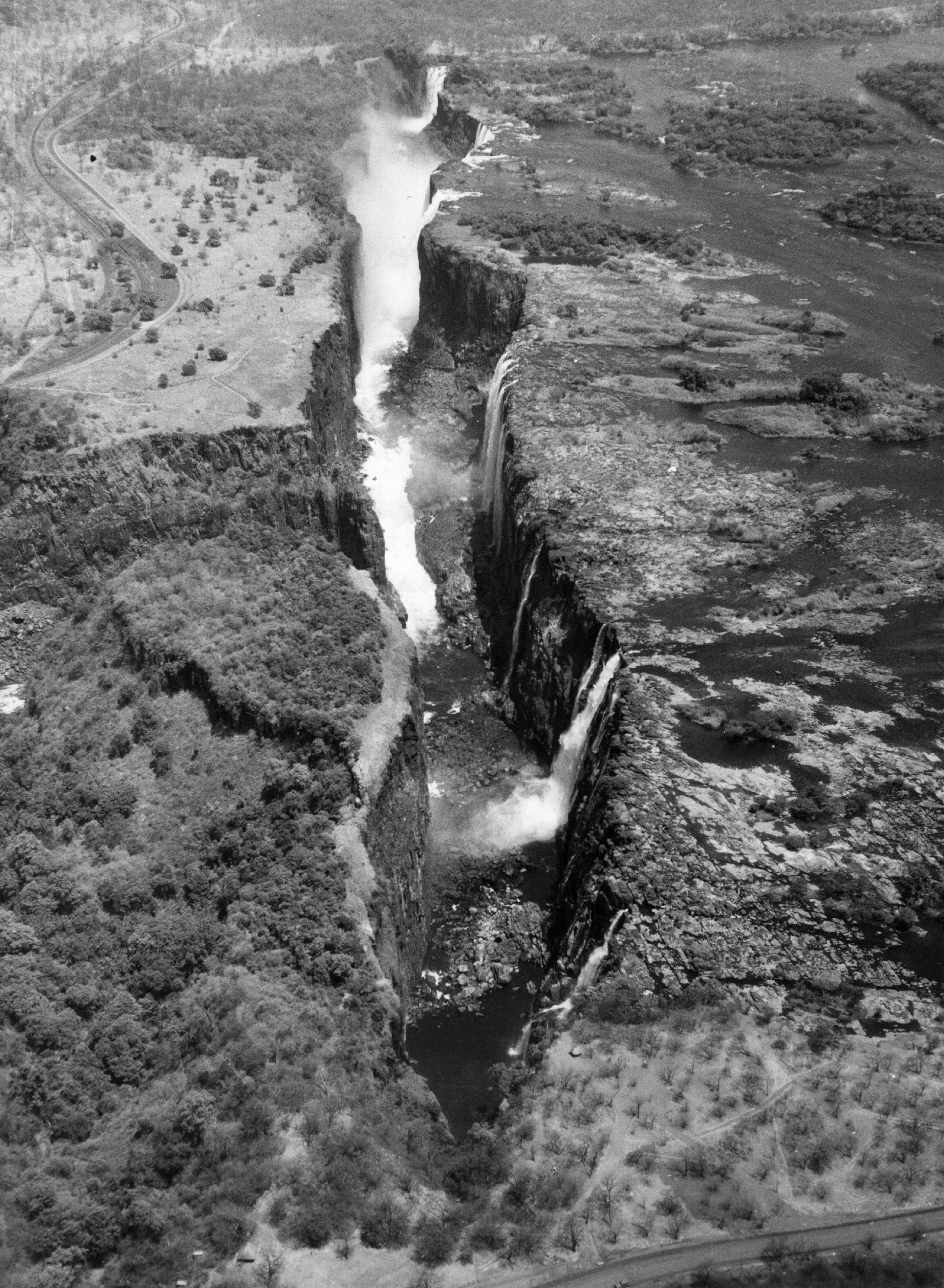 Slide 53 of 55: circa 1960: The Victoria Falls (Mosi oa Tunya) on the borders of Zimbabwe (Southern Rhodesia) and Zambia (Northern Rhodesia) where the Zambesi river plunges 108 metres (355 ft). (Photo by Hulton Archive/Getty Images)