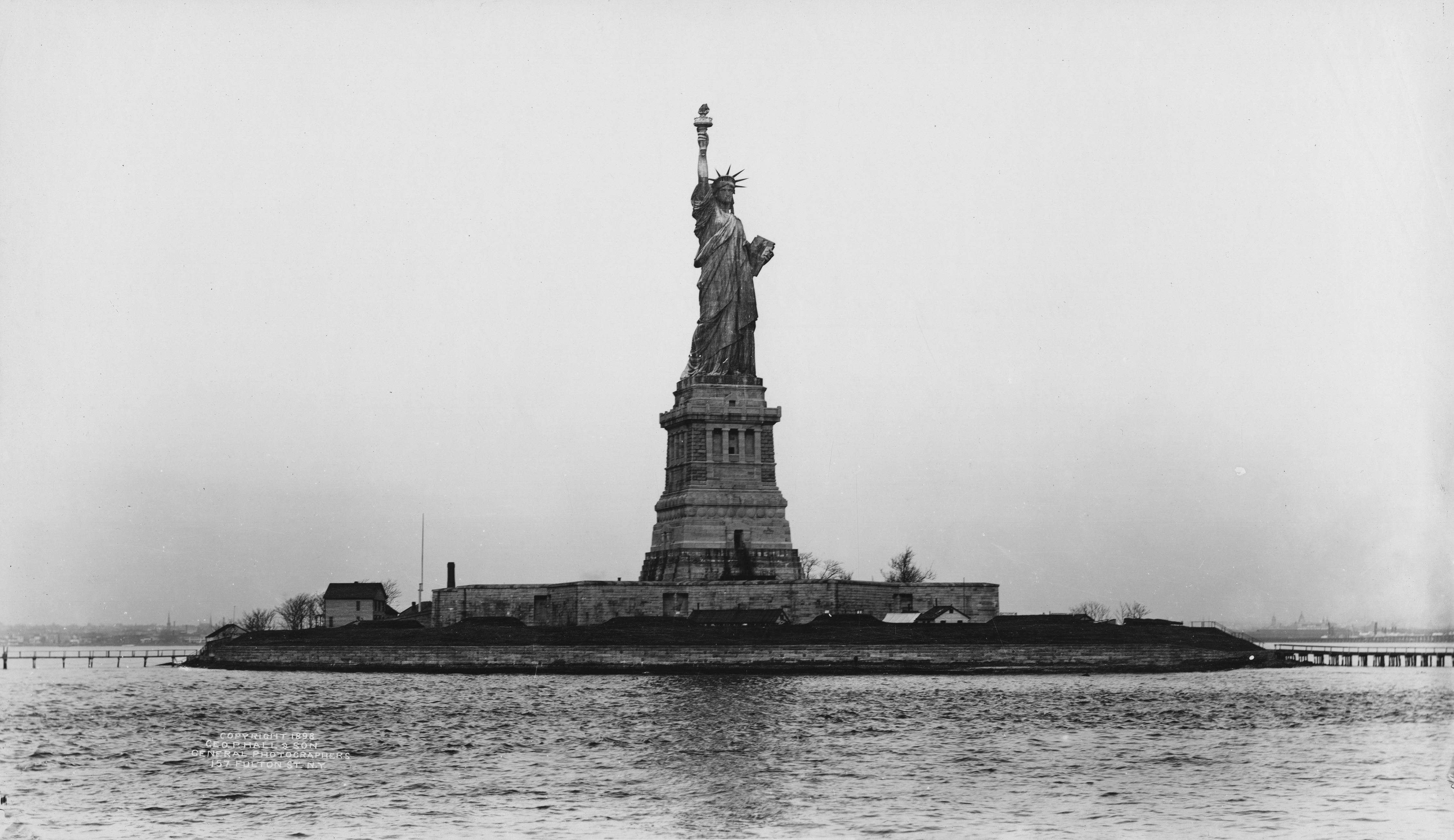 Slide 13 of 55: The Statue of Liberty and Liberty Island, New York, New York, 1898. (Photo by Geo. P. Hall & Son/The New York Historical Society/Getty Images)