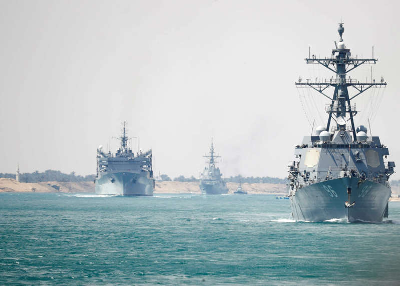 In this Thursday, May 9, 2019 photo released by the U.S. Navy, the Abraham Lincoln Carrier Strike Group transits the Suez Canal in Egypt. The aircraft carrier and its strike group are deploying to the Persian Gulf on orders from the White House to respond to an unspecified threat from Iran. (Mass Communication Specialist 3rd Class Darion Chanelle Triplett/U.S. Navy via AP)
