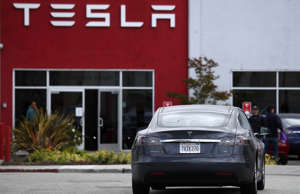 A Tesla Model S drives into the parking lot of a Tesla showroom and service center on May 20, 2019 in Burlingame, California.