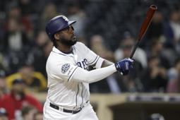 San Diego Padres' Franmil Reyes watches his two-run home run during the sixth inning of a baseball game against the Arizona Diamondbacks, Monday, May 20, 2019, in San Diego. (AP Photo/Gregory Bull)
