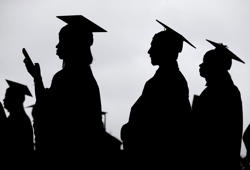 FILE- In this May 17, 2018, file photo, new graduates line up before the start of the Bergen Community College commencement at MetLife Stadium in East Rutherford, N.J. Obtaining a college degree has increasingly coincided with ever-higher student debt loads. Since 2004, total student debt has climbed more than 540 percent to $1.4 trillion, according to the New York Federal Reserve. (AP Photo/Seth Wenig, File)