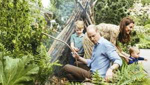 Britain's Prince William, Kate, Duchess of Cambridge and their children, Prince George, Princess Charlotte and Prince Louis play in the Adam White and Andree Davies co-designed garden ahead of the RHS Chelsea Flower Show in London.