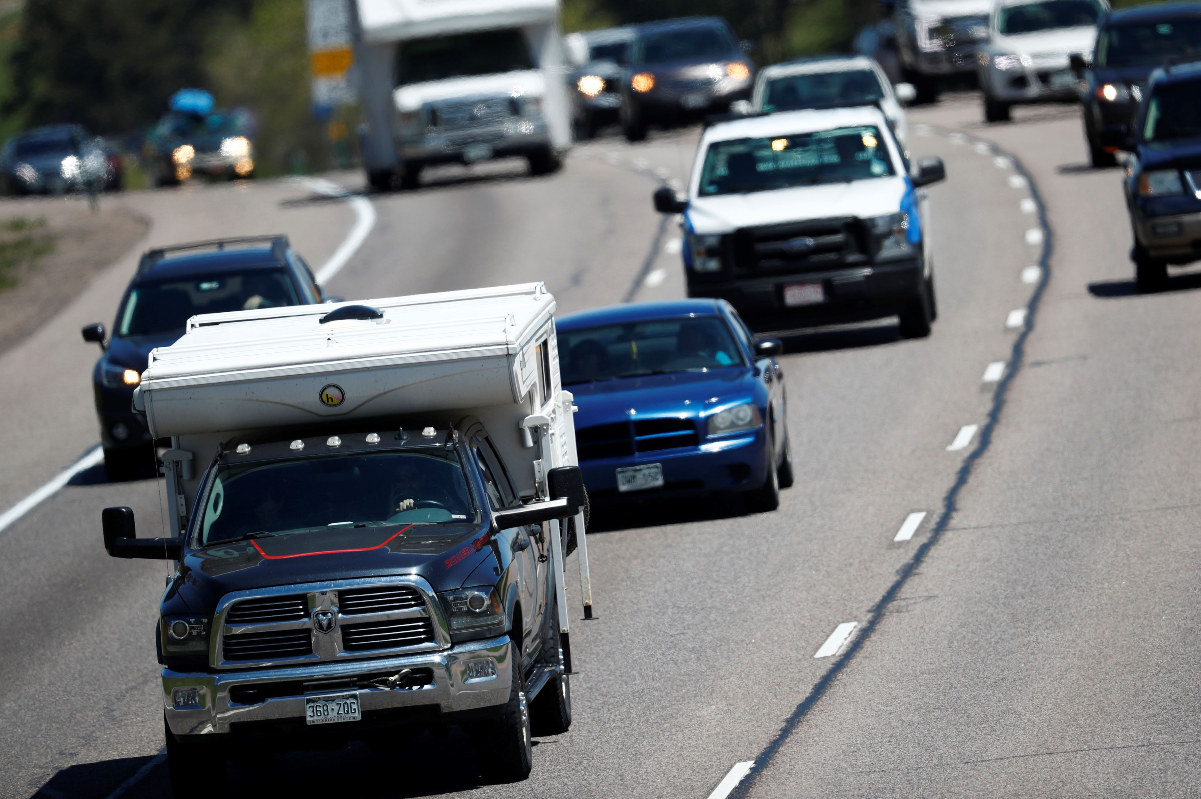 Travelers head westbound on Interstate 70 to kick off the Memorial Day holiday weekend Friday, May 25, 2018, near Evergreen, Colo.